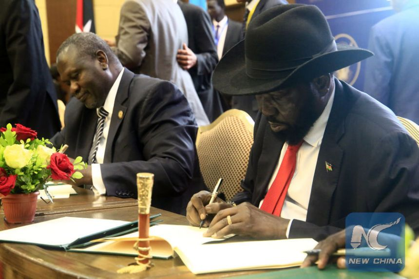 South Sudan President, Salva Kiir, right, and opposition leader Dr. Riek Machar, left, signing a preliminary peace deal in Khartoum, Sudan, (File/Supplied/Nyamilepedia)