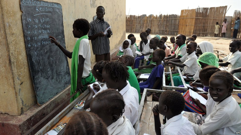 South Sudanese children learning English in a congested open-doors classroom(Photo credit: supplied)