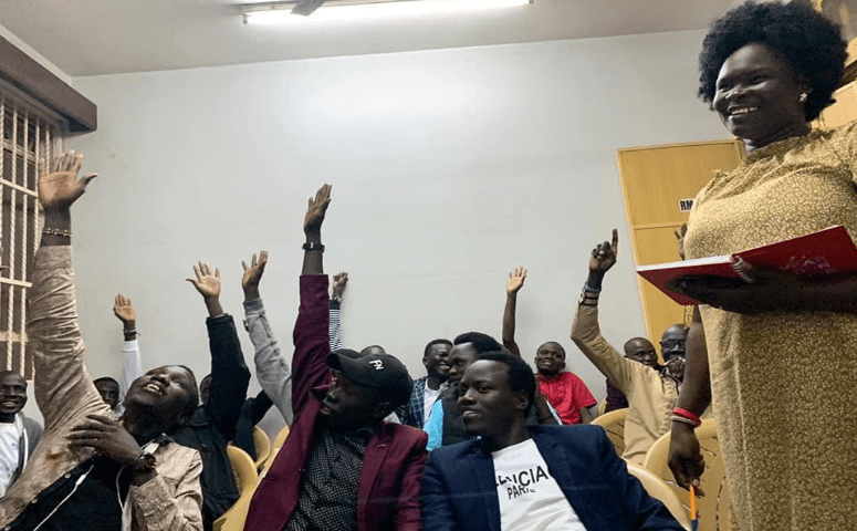 Unity State community Members raising their hands during the meeting on the Change of their community name to Liech community Association in Kenya on 7th, June 2019 in Nairobi Kenya, looking on is constitutional review committee Secretary, Elizabeth Nyajimah Keah(Photo credit: Liech State/Nyamilepedia)