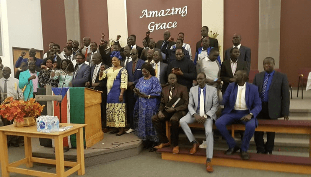 Hon. Henry Odwar posting for a group photo after briefing the SPLM/A(IO) leadership in Alberta Canada, Oct 14, 2019(Photo credit: Nyamilepedia)