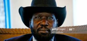South Sudanese President Salva Kiir (L) sit at Khartoum international airport following his arrival for a two-day visit to Sudan that aims at resolving pending bilateral issues, including border disputes, trade and oil agreements on November 1, 2017. / AFP PHOTO / ASHRAF SHAZLY (Photo credit should read ASHRAF SHAZLY/AFP via Getty Images)