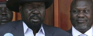 """South Sudan President Salva Kiir Mayardit, centre, and SPLM-IO leader Dr. Riek Machar Teny, right, speaking to reporters at State House """"J1"""" prior to formation of the revitalized unity government in February 2019 (Photo credit: Unknown)"""