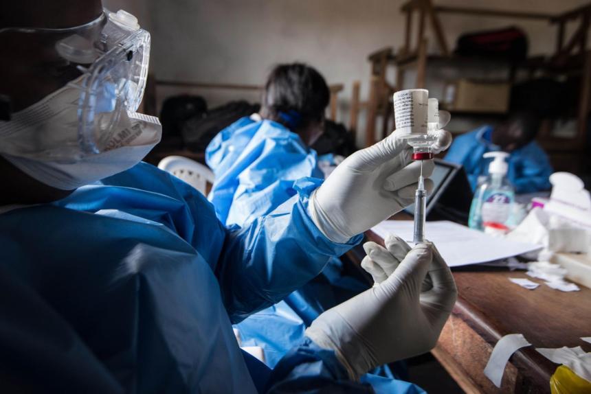 A researcher testing a vaccine in laboratory....