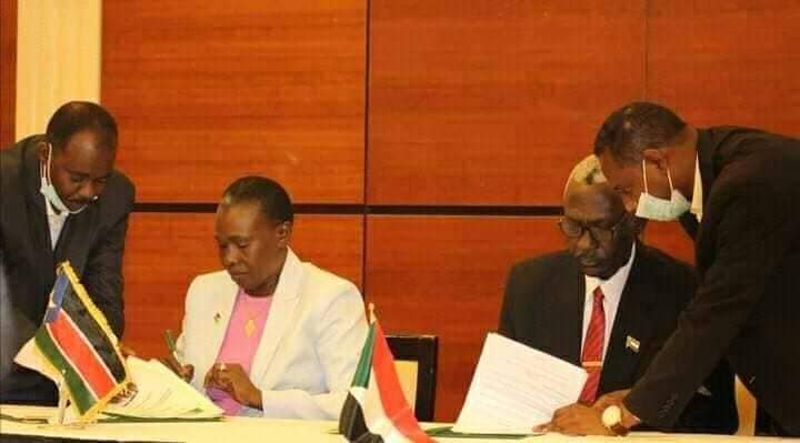 South Sudanese Defence Minister Angelina Teny and her Sudanese counterpart Ibrahim Yassin signing a MOU on Defense and Security(Photo credit: Courtesy image/Nyamilepedia)