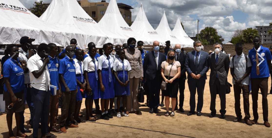 Head of EU Cooperation Wim Vandenbroucke and South Sudan's Minister of Education posting for a picture with students during a back to school event in Juba(Photo credit: EU South Sudan)