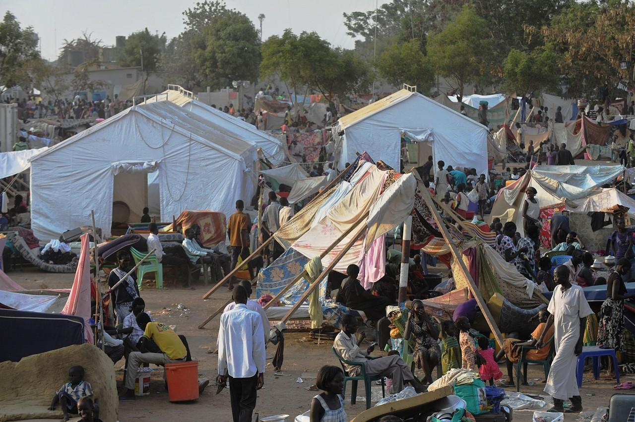 People gather at a makeshift IDP camp at the United Nations Mission in South Sudan (UNMISS) compound in Juba (Photo credit: Tony Karumba/AFP/Getty Images)