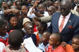 Kenya Education Cabinet Secretary George Magoha during a pre-covid visits to school(Photo credit: supplied/nyamilepedia)