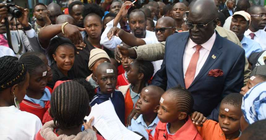Kenya Education Cabinet Secretary George Magoha during a pre-covid visits to school(Photo credit: supplied/nyamilepedia)