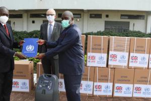 Dr Olushayo Olu, WHO Representative handing over the donation certificate to Dr Mayen Machut Achiek, Undersecretary, Ministry of Health in the presence of Chris Trott, British Ambassador(Photo credit: WHO-South Sudan/Nyamilepedia)