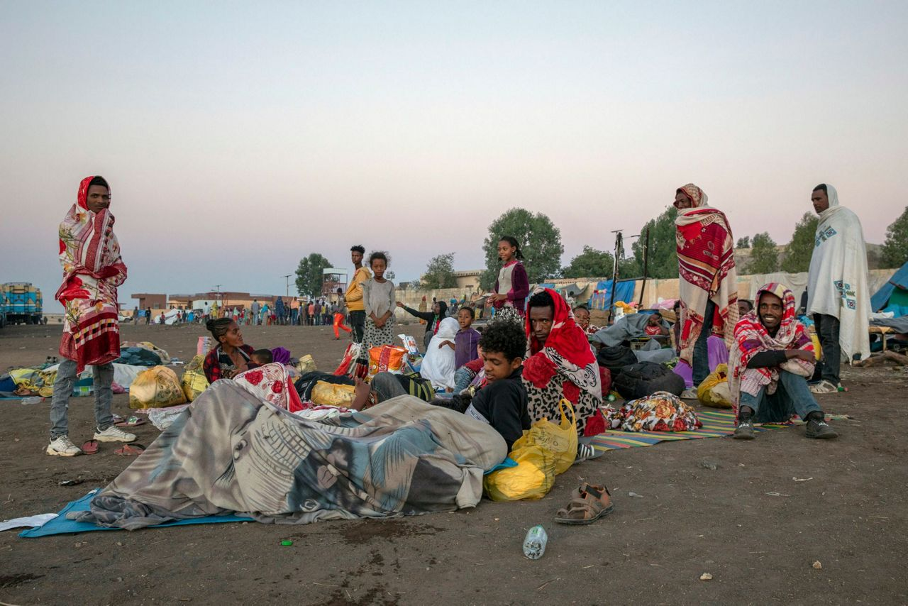 Ethiopian refugees after crossing into Sudan sheltering in an open field(Photo credit: supplied)