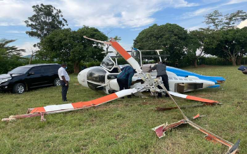 Picture of the choppers landing on its right side after crashing in Siaya County(Photo credit: Standard Kenya)