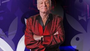 Playboy magazine founder Hugh Hefner poses for photos at the Playboy Mansion in Los Angeles