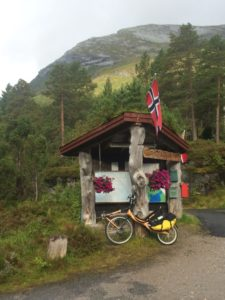 Bike, Norwegian flags, Rte. 13, mountain and info. sign.