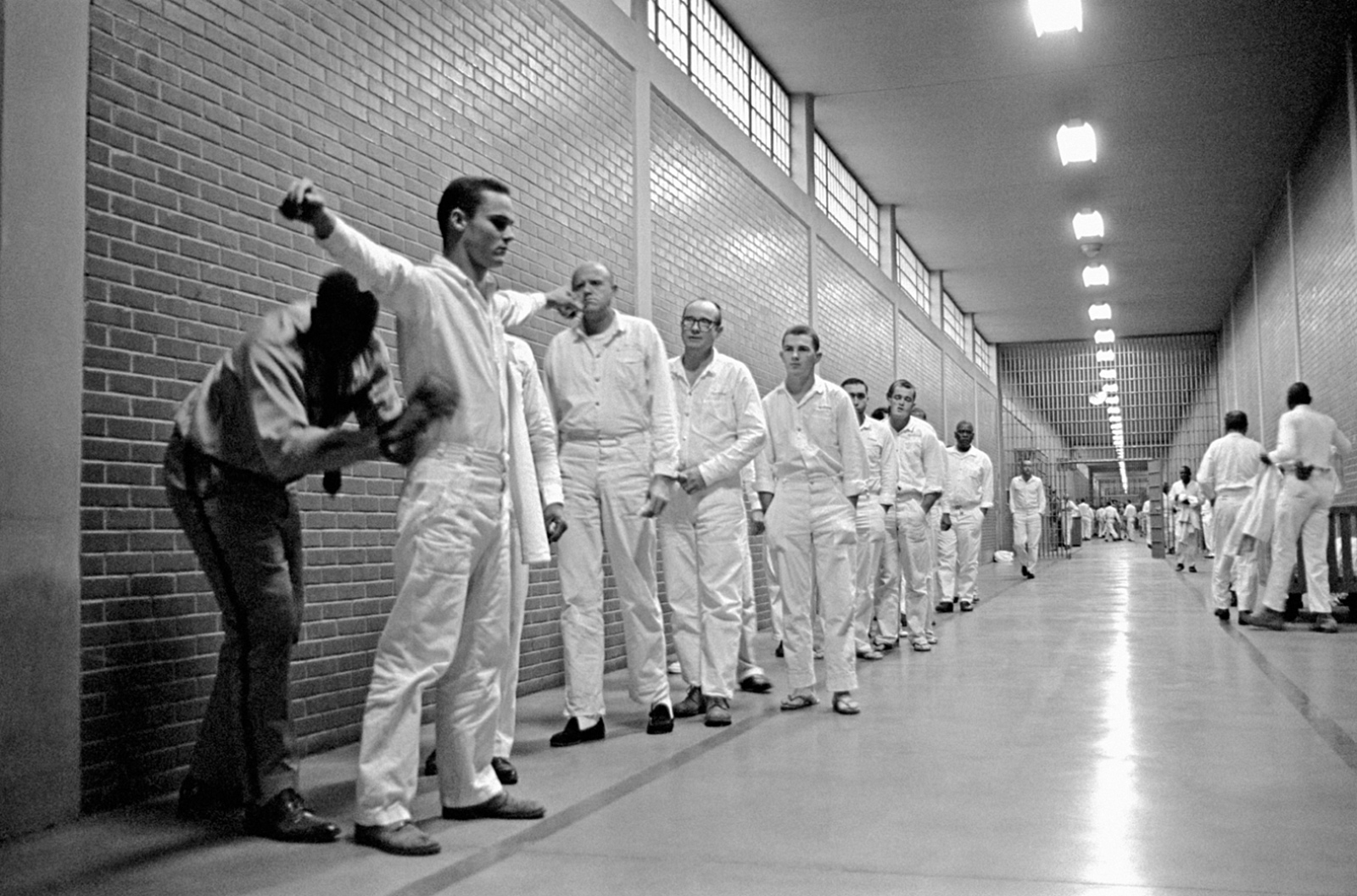 A shakedown of inmates in the main corridor of the Ellis Prison Farm, Huntsville, Texas, 1968; photograph by Danny Lyon from his 1971 book Conversations with the Dead, which has just been reissued by Phaidon. A retrospective of his work, 'Danny Lyon: Message to the Future,' will be on view at the Whitney Museum of American Art, New York City, June 17–September 25, 2016.