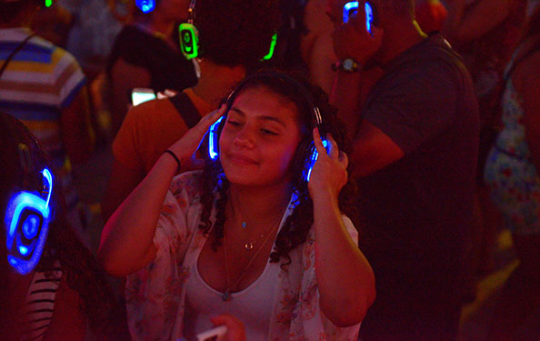 a girl dances while listening to music on headphones