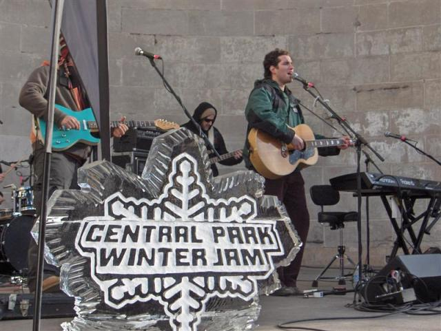 A band performs on stage at Winter Jam's main location at the bandshell.