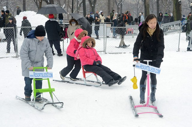 Guests, including kids, learn how to snow shoe on a snow field.