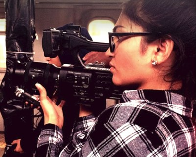 A teen girl filming in the subways.