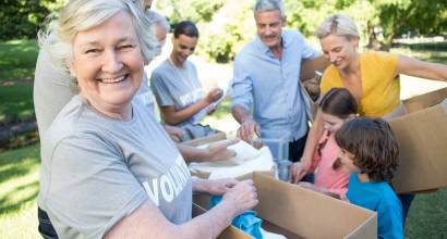 Older woman sorts donations as part of a volunteer job