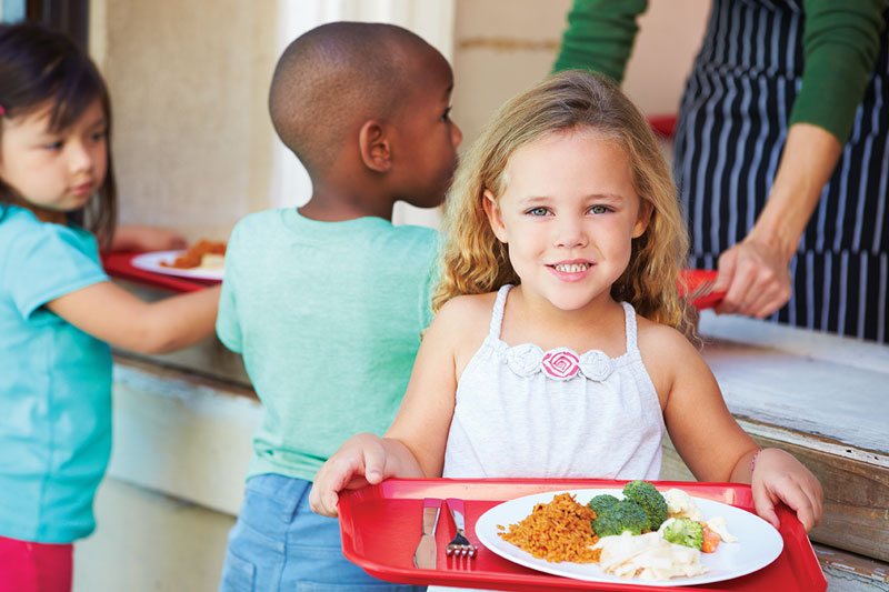 Young girl with school lunch