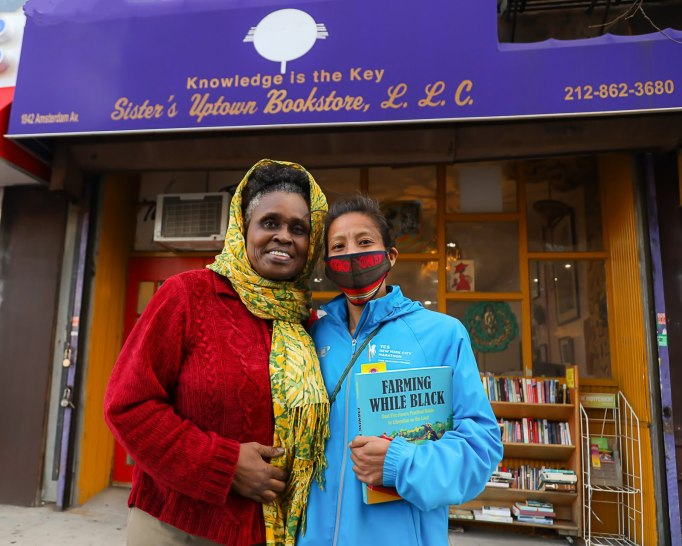 Two women in front of an independent bookstore