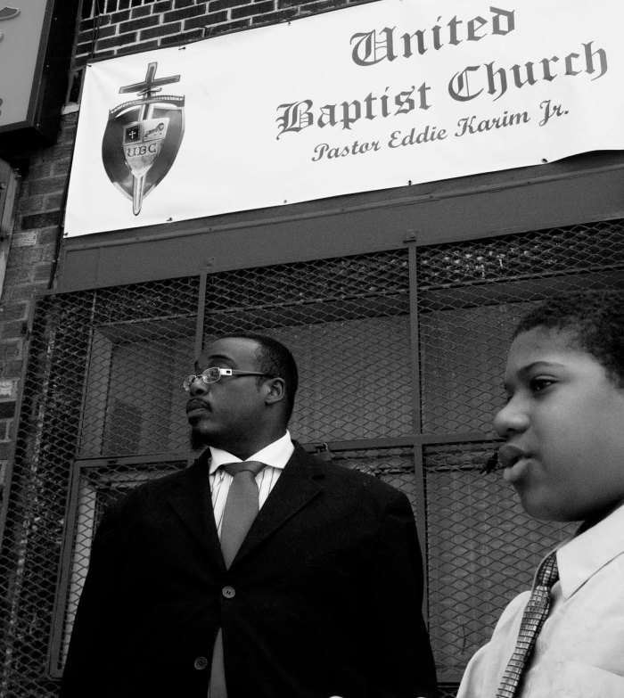 Reverend Eddie Kasim with a young disciple talking about his faith. Photo: Tony Carnes/A Journey through NYC religions