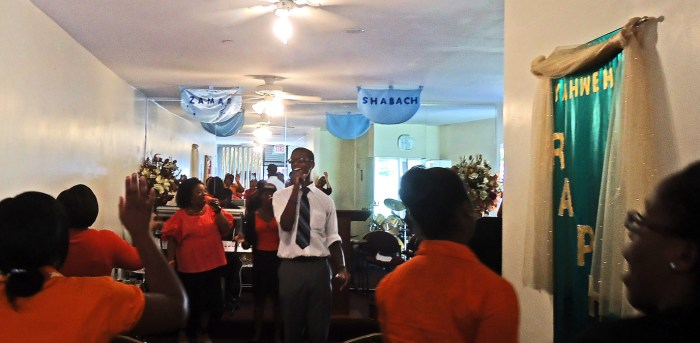 Singing, dancing & preaching in the aisle at Cornerstone International Fellowship, Crown Heights, Brooklyn. Photo: Melissa Kimiadi/A Journey through NYC religions