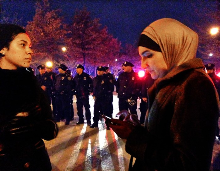 Guiding her troops, Linda Sarsour, r, with another woman. West Side Heighway at West 11th Street. Photo: Pauline Dolle/A Journey through NYC religions