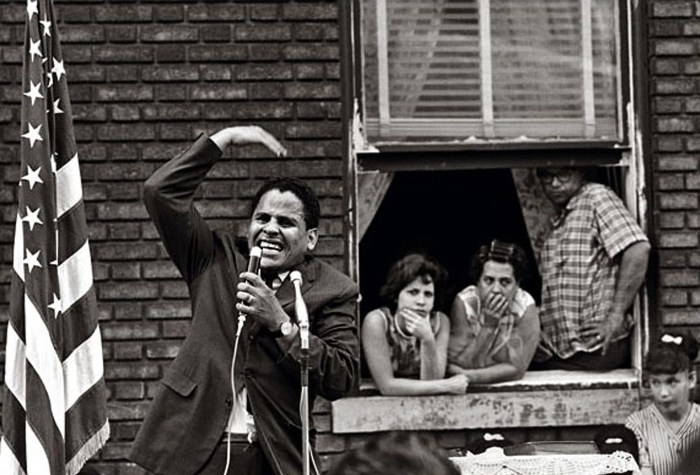 "El Ministro, Pentecostal street service, Brooklyn, New York, 1964. Photo: Frank Espada/Library of Congress, The Puerto Rican Diaspora. From ""Evangelicals respond to The Storm of 1960-1977 in Williamsburg & Greenpoint, Brooklyn"""
