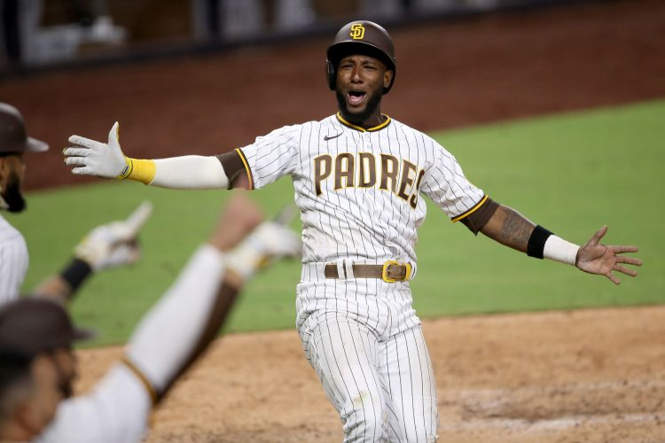 SAN DIEGO, CALIFORNIA - JULY 24:  Jurickson Profar #10 of the San Diego Padres reacts after scoring on a Eric Hosmer #30 of the San Diego Padres RBI doiuble during the seventh inning of the Opening Day game  at PETCO Park on July 24, 2020 in San Diego, California. (Photo by Sean M. Haffey/Getty Images)