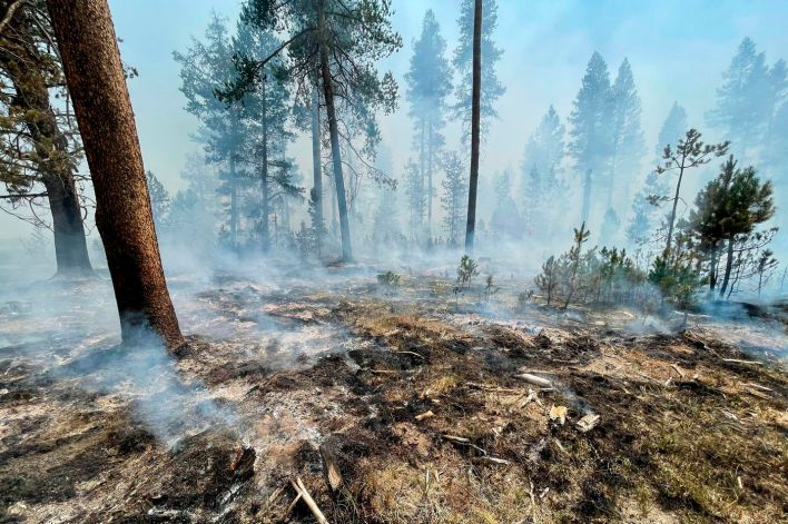 In this photo provided by the Bootleg Fire Incident Command, the Bootleg Fire is seen smoldering in southern Oregon on Saturday, July 17, 2021.