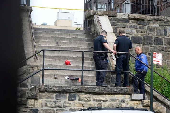 NYPD investing the staircase where friends and family disclose Jason Hooks was shot in Bronx