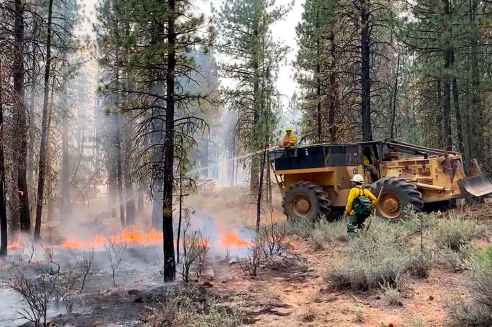 Firefighters battle the Bootleg Fire in southern Oregon on Saturday, July 17, 2021.