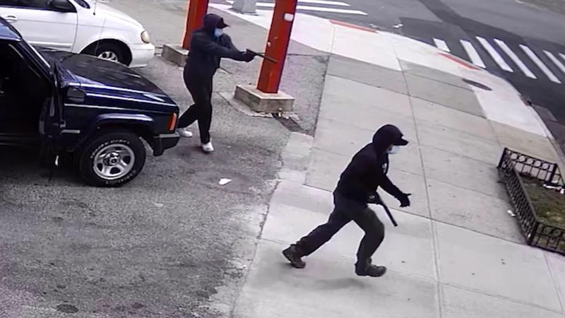 Two masked bandits hopped out of their Jeep wielding silenced pistols and shot down a 51-year-old man in the Bronx on May 2.
