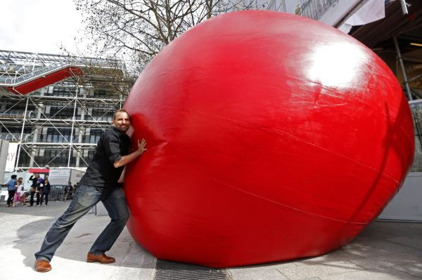 Giant Red Ball Breaks Free Art Installation