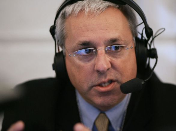 Marc Bernier of station WNDB of Orlando, Florida speaks to White House Deputy Chief of Staff Karl Rove during a radio interview in October 2006 at an event for radio talk shows at the White House in Washington, DC.