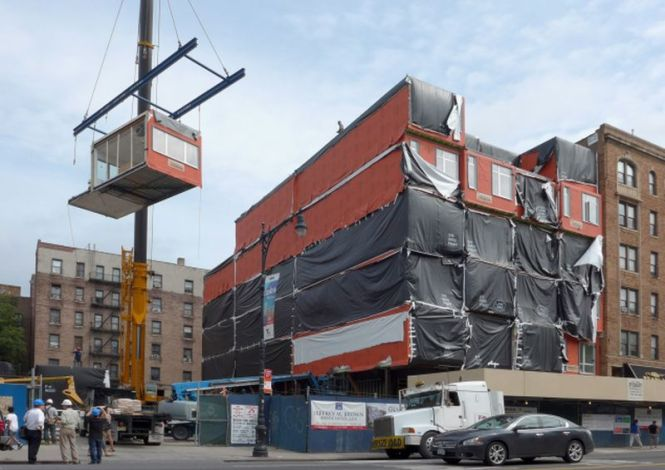 Pre Fab Modules Are Raised And Stacked At An Innovating Building Curly Under Construction In