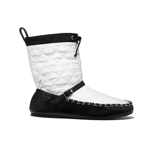 White and black boots in fabric and leather