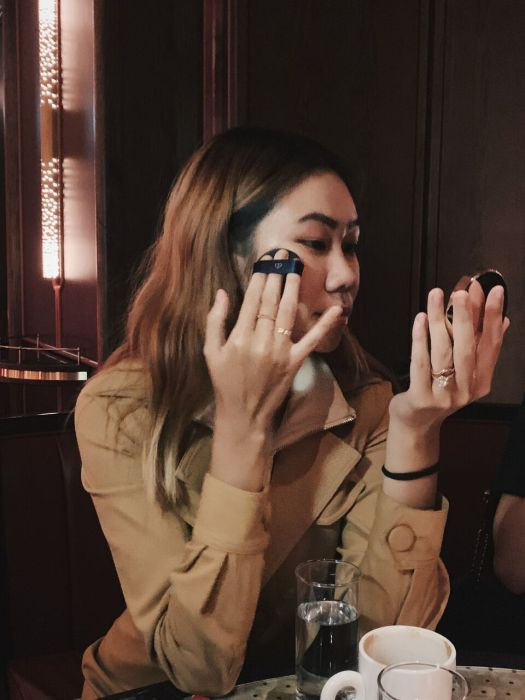 Nellie Lim touching up with Clé de Peau's Radiant Cushion Foundation at Idlewild.