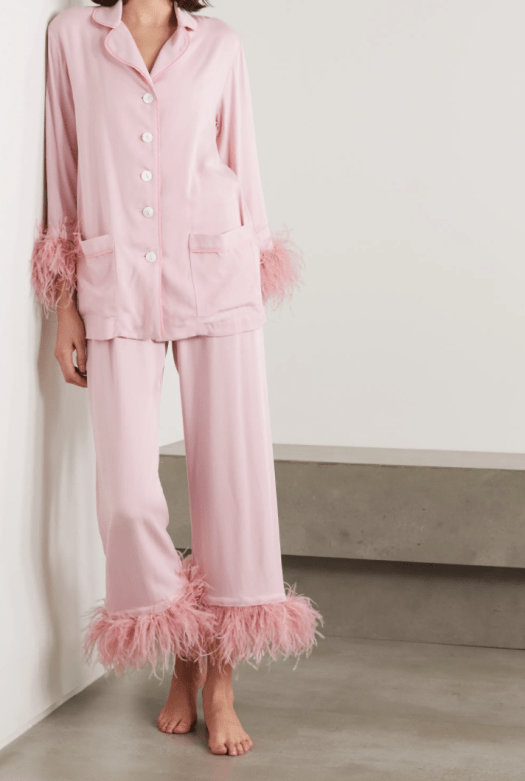 SLEEPER PARTY FEATHER-TRIMMED CREPE DE CHINE PAJAMA SET, $347, available at NET-A-PORTER | Staying home for Valentine's Day can be a fancy affair too when you've got this vintage-inspired pajama set — note the tonal piping, mother-of-pearl buttons, and of course, flamboyant feathers at the hem.