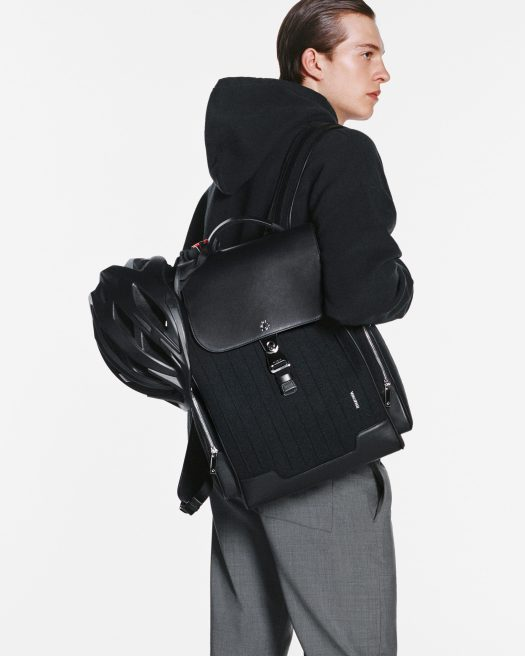 RIMOWA NEVER STILL BACKPACK - BLACK, $1,540 | Rimowa's series of everyday essentials are as sleek as their suitcases of course, especially this roomy backpack made from durable canvas and full-grain leather. No matter his profession, your man will get to walk around with effortless style.