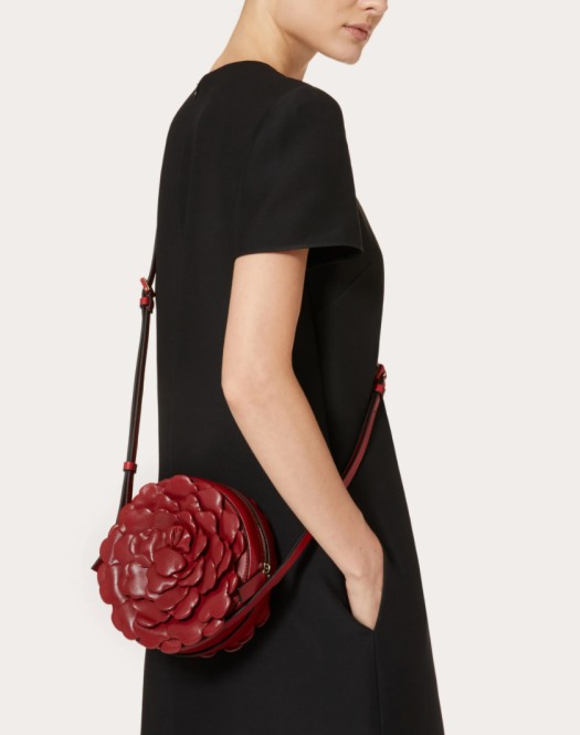 VALENTINO GARAVANI 03 ROSE EDITION ATELIER ROUND CROSSBODY BAG, USD2,780 | Shaped like a blooming rose, with leather petals arranged in amazing 3D detail, this round crossbody bag is a stunner. One to collect if you're a super romantic.