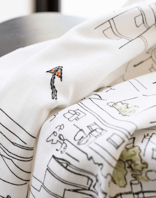 Close-up of embroidery on the LOKALT throw