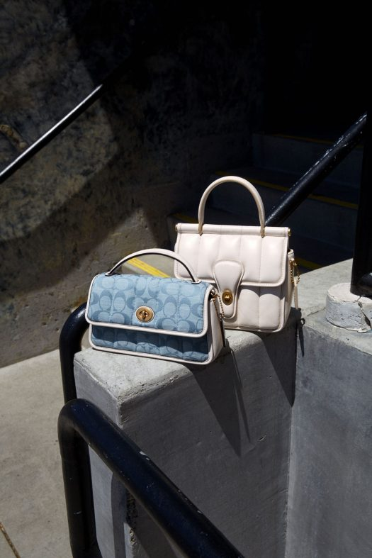 TURNLOCK CLUTCH 20 IN SIGNATURE CHAMBRAY WITH QUILTING, $750 ; WILLIS TOP HANDLE 18 WITH QUILTING, $750.