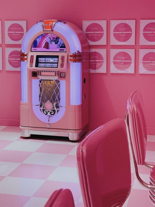 The classic jukebox at SCREAM'S DINER, which plays timeless hits you can groove along to.