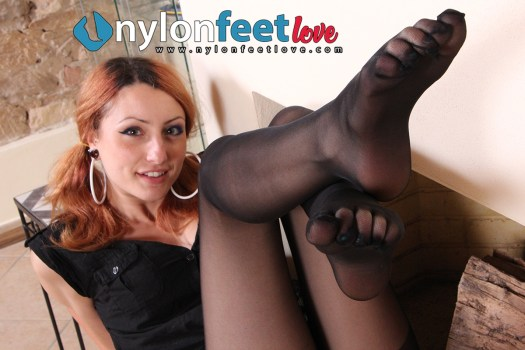 Thena shows her beautiful feet in black pantyhose