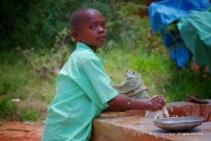 African Boy water Nyumbani