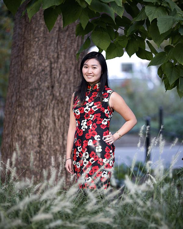 Emily Liu, a member of the Chinese Mei Society, is pictured wearing a traditional Chinese dress.