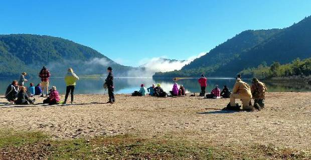The remnants of the fog lift as the Monday Walkers enjoy a coffee stop with a view over Lake Tikitapu.