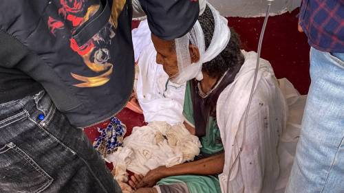 An elderly woman who fled to Axum in the Tigray region of Ethiopia to seek safety sits with her head bandaged after being wounded during an attack on the city. Photo / AP
